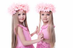 Two beautiful little girls in pink dresses - stock photo