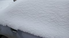 Car in snow, person sits in the snow-covered car Stock Footage
