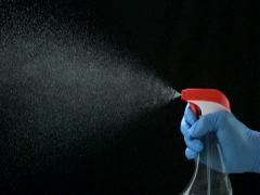 Using spraying bottle and cleaning, Slow Motion Stock Footage