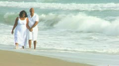 Laughing Senior Ethnic Couple Quiet Beach Time Stock Footage