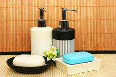 Soap dispensers and bars Stock Photos