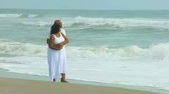 Contented Senior Ethnic Couple Quiet Beach Time Stock Footage