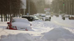 The strong snow cyclone in the city:bad weather,difficult traffic,extreme frost! - stock footage