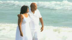 Contented Senior Ethnic Couple Quiet Beach Time Stock Footage