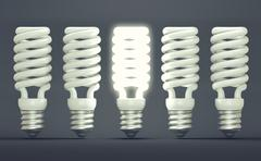 idea or invention: illuminated efficient bulb among group of off ones - stock illustration
