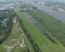 Aerial shot Industrial area along River Lek (Rhine) Holland Stock Footage