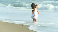Hispanic Loving Mother Little Boys Ocean Surf Stock Footage