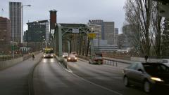 Transit Bus Pedestrians & Cyclists Crossing Portland Hawthorne Bridge in Eve Stock Footage