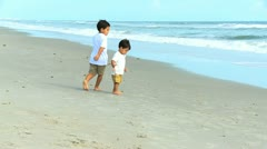 Happy Little Hispanic Brothers Playing Beach Stock Footage