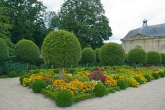 Formal garden, flowers and box tree cut  France - stock photo