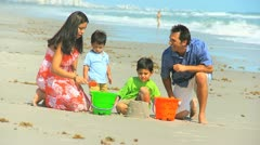 Young Hispanic Family Playing Sand Beach Outing Stock Footage