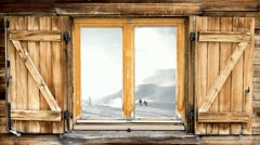 Mountain hut window skiing scene reflection Stock Footage