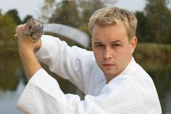 Karate boy with katana Stock Photos