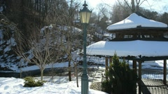 Wooden bower roof snow retro lighting river bank winter park Stock Footage