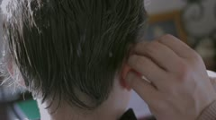 Treating a boy's hair against lice Stock Footage
