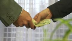 Business man and woman exchange money Stock Footage