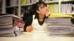 Brunette businesswoman among piles of files - stock footage