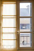 textile drapes on sunny window - stock photo