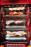 Roasting meat on spit Stock Photos