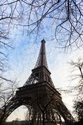 Eiffel tower and tree branches in paris Stock Photos