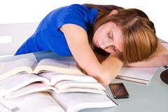 College student sleeping on her desk Stock Photos