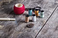 Many bobbin of thread with needle and button Stock Photos