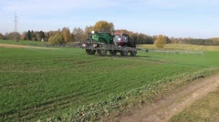 Griculture tractor spraying crop field Stock Footage