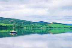 Sailing boat in moray firth near loch and river ness. landscape in inverness Stock Photos