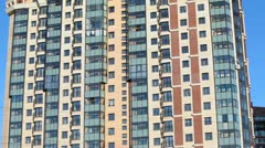 The facade of a high-rise apartment building. Camera zoom in Stock Footage