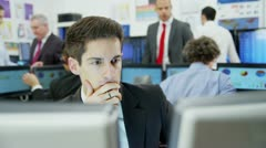 Young and ambitious financial trader is concerned when the stock market crashes - stock footage