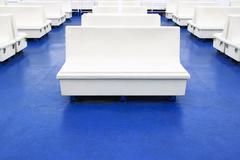 Stock Photo of white seat or bench on a ferry boat as background