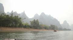 Moving Guilin China Chinese water river raft passing boats beautiful mountain Stock Footage