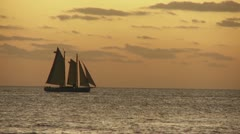 A beautiful sailing ship at sunset. Stock Footage