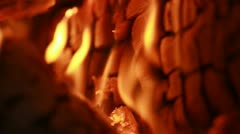 Stock Video Footage of Flames Cover Firewall of Cracked Log in Fireplace - 25FPS PAL
