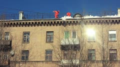 Remove snow on the roof. Moscow, 26 march 2013. Stock Footage