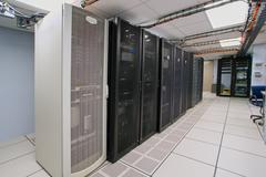 Modern interior of server room in datacenter Stock Photos