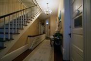 Staircase and a hallway inside historic house Stock Photos