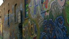 Epic Graffiti Street Art on Brick Wall in Boise Alley Stock Footage