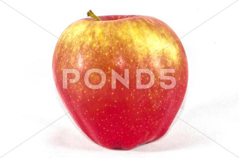 Stock photo of appetizing apple isolated on white background.
