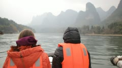 Still Guilin China Chinese river two people tourists raft boat scenic Stock Footage