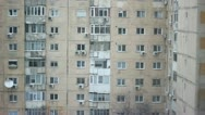 Snow falling over old buildings constructed during the communist era Stock Footage