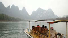 still Guilin China river raft boat famous nine horse fresco hill mountain mural - stock footage