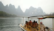 Stock Video Footage of still Guilin China river raft boat famous nine horse fresco hill mountain mural