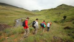 A group of backpackers hiking in the Drakensberg Stock Footage