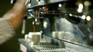 Stock Video Footage of Barista makes two coffees in coffee bar