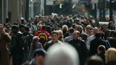 Crowd of people walking on a street - stock footage
