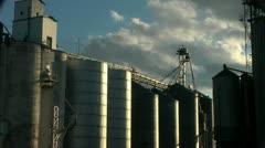 Clouds over grain silos Stock Footage