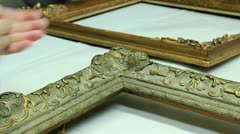 Stock Video Footage of Restoring Art: Picture frame repairing