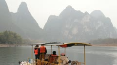 Wide still Guilin China river raft boat famous nine horse fresco hill mountain Stock Footage