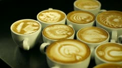 Pan across coffee cups Stock Footage